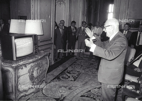 AAE-F-182029-0000 - The President of the Italian Republic Sandro Pertini celebrates in front of the TV after the Italy-Brazil soccer match of the World Championships in Spain - Data dello scatto: 05/07/1982 - © ANSA under licence Archivi Fratelli ALINARI