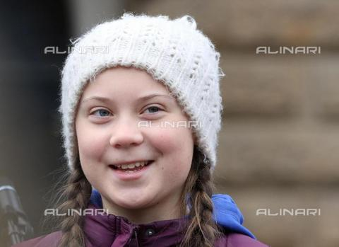 "AAE-S-510122-6511 - Swedish climate activist Greta Thunberg, 16, smiles during the ""Friday for the future"" demonstration against climate change in front of the city hall in Hamburg on March 1, 2019 - Data dello scatto: 01/03/2019 - EPA/FOCKE STRANGMANN / © ANSA under licence Archivi Fratelli ALINARI"