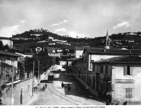 ACA-F-003257-0000 - The via di San Domenico that continues to the hill town of Fiesole, animated by walking people and a passing street car. Florence