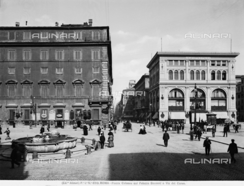 ACA-F-006310-0000 - View of the Piazza Colonna with Palazzo Bocconiand Via del Corso in Rome. On the left Palazzo Chighi and a fountain, in the center Via del Corso, on the right Palazzo Bocconi or Palazzo della Rinascente, typical commercial building of the end of the XIX century.