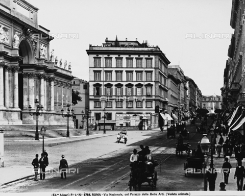 ACA-F-006784-0000 - View of Via Nazionale in Rome, driven by carriages. On the left, the Palace of Exhibitions ( formerly seat of the Fine Arts )