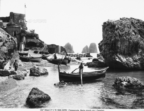 ACA-F-011516-0000 - Rocks at the Marina Piccola of Capri. A man docking his boat is in the foreground
