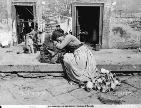 ACA-F-011651-0000 - Young pottery vender asleep in a street in Naples