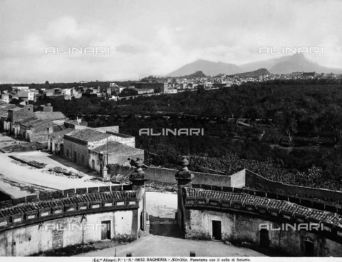 ACA-F-019632-0000 - View of Bagheria with panorama of the hills of Solunto. A circular construction with internal courtyard is visible in the foreground.