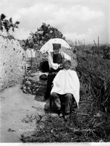 ACA-F-032592-0000 - Photograph of a man shaving in a clearing in the open countryside, city of Tratalias, Sardinia.