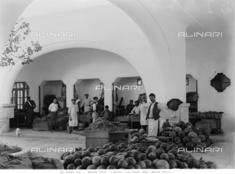 ACA-F-057440-0000 - Great arch of the Dimotiki agore, construction used as a market, under which cellars are visible. A melon vendor is in the foreground. Island of Kos
