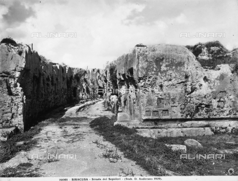 ADA-F-029361-0000 - View of the Via dei Sepolcri in Syracuse, cut in the rock between two vertical walls with a curving path.