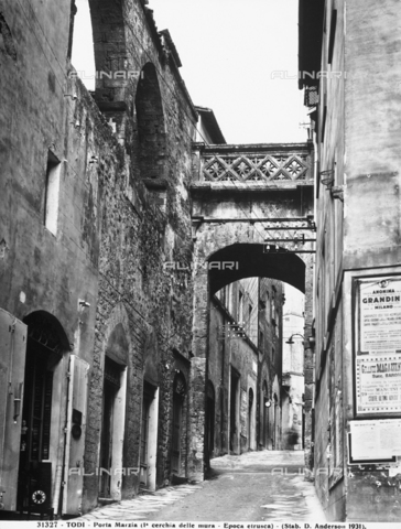 ADA-F-031327-0000 - The Porta Marzia in Todi, a Medieval arch built with Roman blocks of stone and surmounted by an elegant balustrade