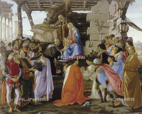 AGC-F-000213-0000 - 'Adoration of the Magi', by Sandro Botticelli, in the Uffizi Gallery in Florence. The paitning shows a large group of persons gathered around Joseph and the Madonna with the Child on her knee. Some of the people in the group are portraits of members of the Medici circle, such as Lorenzo the Magnificent, Agnolo Poliziano, Pico della Mirandola, Cosimo il Vecchio, Piero the Gouty, Giovanni and Giuliano dei Medici, perhaps Giovanni Agiropulo, Lorenzo Tornabuoni and the donor Lami. On the far right of the work is a self portrait of Botticelli. The scene is set before a shed with a ruined loggia in the background - Date of photography: 1990 - Alinari Archives, Florence, Reproduced with the permission of Ministero per i Beni e le Attività Culturali