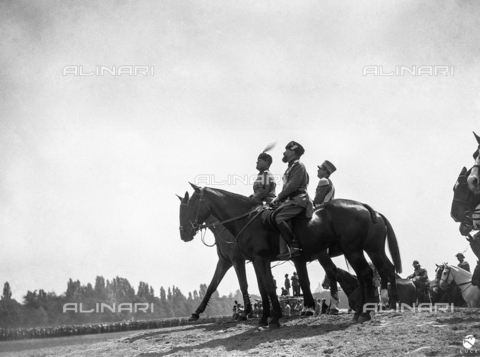 AIL-F-021066-0000 - Duce's trip to Tuscany: Benito Mussolini, Attilio Teruzzi and a general of the royal army assist riding the military parade racecourse Cascine - Data dello scatto: 18/05/1930 - Luce Institute/Alinari Archives Management, Florence