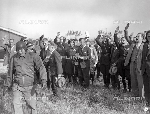AIL-F-060502-0000 - Greeting Fascist to Benito Mussolini aviator seal during his meeting with the Austrian Chancellor Kurt Schuschnigg in an airfield near Florence - Data dello scatto: 12/05/1935 - Luce Institute/Alinari Archives Management, Florence