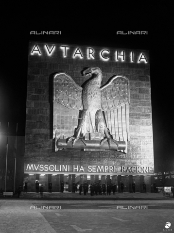 "AIL-F-087322-0000 - The central pavilion with the inscription on the facade ""Autarchia Mussolini is always right"" for the autarchic exhibition of Italian minerals at Circus Massimo, Rome - Data dello scatto: 18/11/1938 - Luce Institute/Alinari Archives Management, Florence"