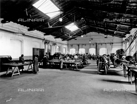 APA-F-008425-0000 - Allover view of the interior of the Conceria Pedani. A few workers are preparing the hides at machines and on tables