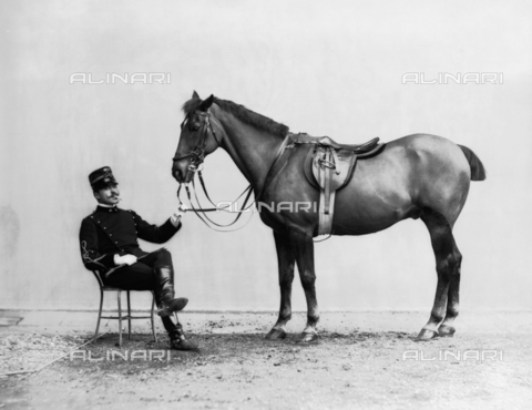APA-F-02412B-0000 - Lieutenant Solaro next to his horse