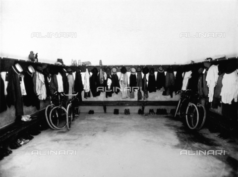 APA-S-008431-0002 - Interior of the Conceria Pedani. The wardrobe in a large room where workers' clothing is hung, a few bicycles have been left here and containers for beverages and food are stored