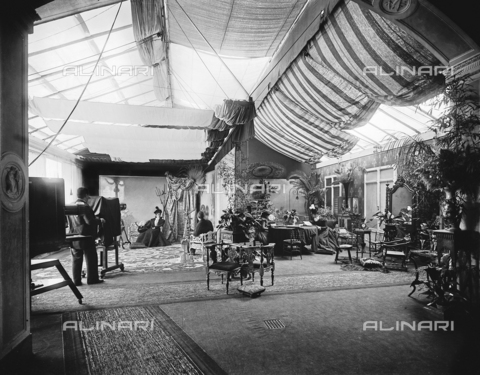 APA-S-011953-0007 - The luminous portrait studio of the Alinari Brothers' photographic establishment, in Florence. On the left the photograph Gaetano Puccini