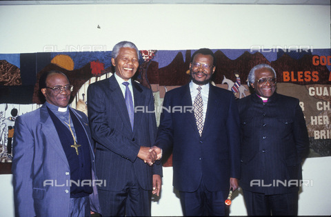 APN-F-014603-0000 - South Africa  Johannesburg  June 1991: Bishop Magopa  Nelson Mandela  Chief Buthelezi and Archbishop Tutu  at Peace Meeting. Goverment  IFP - Inkatha Freedom Party  ANC - African National Congress  goverment  political.Photograph: Graeme Williams/ South - South Photographs / Africamediaonline/Archivi Alinari, Firenze