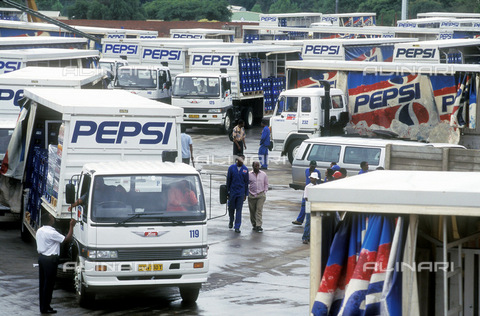 APN-F-014674-0000 - South Africa  Johannesburg  1996: Pepsi soft drink delivery trucks wait to be loaded up for delivery. loading dock  bay  business  corporation work jobs employment  trade  firm  organization. trucking  depotPhotograph: Graeme Williams/South - South Photographs / Africamediaonline/Alinari Archives, Florence