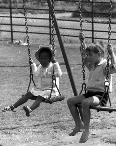 APN-F-036754-0000 - SAED: SOCIAL: CHILDREN: 1950s - Children playing in a park. (Photograph by Drum Photographer Baileys Archives) - Baileys African History Archive / Africamediaonline/Alinari Archives, Florence