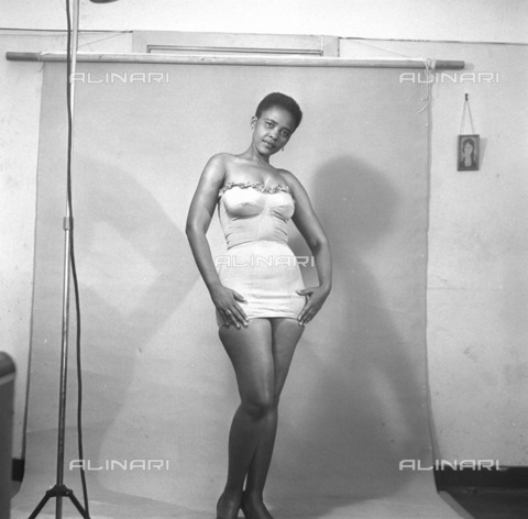 APN-F-116262-0000 - 1956 - Hazel Futa - A Day In The Life Of A Cover Girl - Her temper flared, her beauty glowed, and in a moment I new the Hazel Futa that takes no sass from nobody not even reporters. She 's a woman of spirit, determined to get some place in this dog's life - Africamediaonline/Alinari Archives, Florence, Baileys African History Archive