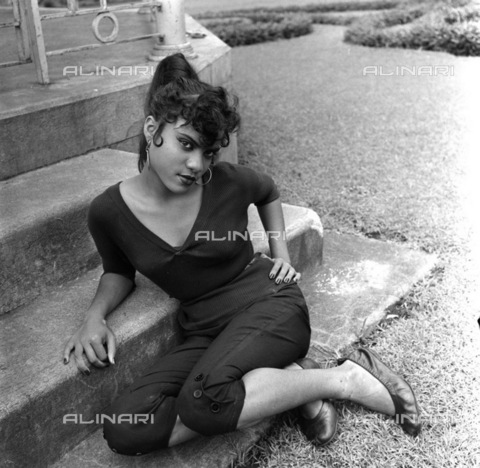 APN-F-116281-0000 - SEP1957 - Stella Anthenifus From Mombasa - East Africa Beauty, she was walking down the Nairobi main street, male eyes popping out all the way round her, when our East Africa scout spotted her - THAT was easy enough - gath-ered up his courage, and asked h - Africamediaonline/Alinari Archives, Florence, Baileys African History Archive