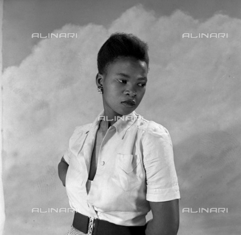 APN-F-116284-0000 - NOV1952 - Cover Girl's Story - Miriam Dhlamini, 22-year-old domestic servant tells of her dreams, romances,and success. 'I was born in Prospect Township, Johannesburg, in 1930. You won't find it there now, it has ben demolished to make way for the Kazerne - Africamediaonline/Alinari Archives, Florence, Baileys African History Archive