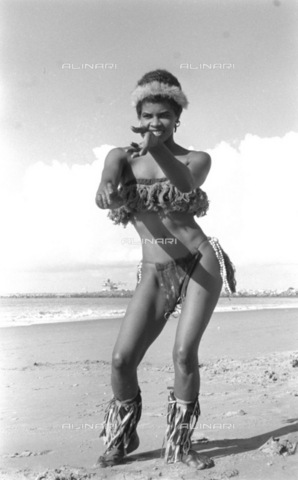 APN-F-116305-0000 - 1958:Irene Batchelor - The Girl Who Took Over -Irene Batchelor, the 27 year old Cape Town Beauty Queen, is the new sizzling, snake dancer in the 'folies' show. This sentimental blues singer, with a Marilyn-wiggle, was first chosen as a substitute for Dott - Africamediaonline/Archivi Alinari, Firenze, Baileys African History Archive
