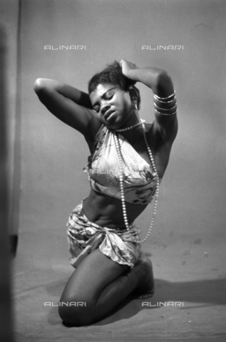 APN-F-116328-0000 - JAN1956 - Ivy Burns The Congo Dance - Ivy Williams; 'I happen to think that this business of coy maidenhood is out of date. My desires, my impulses, my reactions are things that I play with a frankness that often shocks my sisters'. (Photograph by G.R.Nai - Africamediaonline/Archivi Alinari, Firenze, Baileys African History Archive