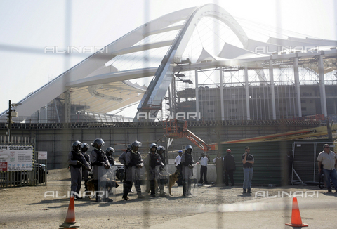APN-S-008075-2010 - Private security guards in riot gear and armed with pepper guns keep watch as construction workers picket in front of the Moses Mabhida stadium being constructed for the 2010 World Cup in Durban, July 10, 2009. Picture by Rogan Ward - Africamediaonline/Archivi Alinari, Firenze