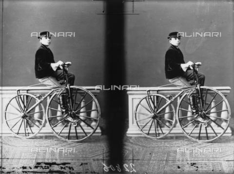 ARA-F-00777M-0000 - Portrait of little boy on a bicycle