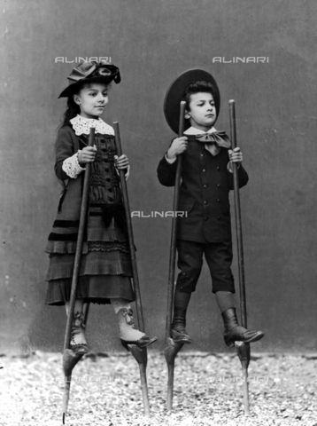 ARA-F-00991M-0000 - Romualdo Alinari sons, Adele and Arturo, on stilts, Florence