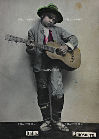 "AVQ-A-000145-0120 - ""Alrededor del Mundo - Obsequio de Susini"". Portrait of a boy playing the guitar; the support contains the indication ""Almoner"""