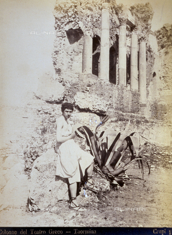 AVQ-A-000209-0006 - Portrait of a boy in Hellenistic style clothes. The boy is sitting in front of the ruins of the Greek Theatre in Taormina, Italy - Date of photography: 1870-1890 ca. - Fratelli Alinari Museum Collections, Florence