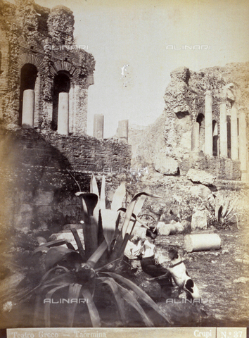 AVQ-A-000209-0007 - The ruins of the Greek Theatre in Taormina, Italy. In the foreground, half hidden by a large agave plant, a child is playing with a dog - Date of photography: 1870-1890 ca. - Fratelli Alinari Museum Collections, Florence
