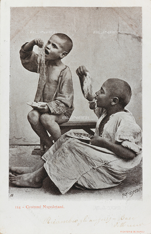 AVQ-A-000216-0071 - Costumes of Naples. Portrait of two children eating a plate of spaghetti with their hands, postcard