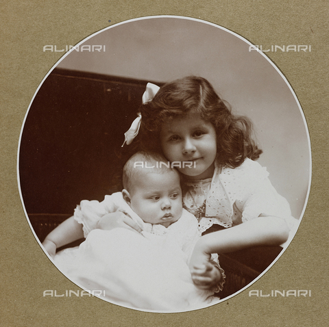 AVQ-A-000553-0027 - Portrait of little girl with baby