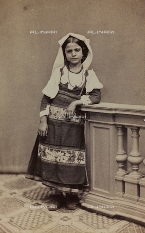 "AVQ-A-001220-0013 - Album ""Traditional costumes"": portrait of little girl in traditional costume of Saracinesco"