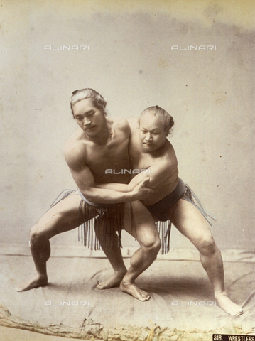 AVQ-A-001344-0104 - Two Japanese sumo wrestlers engaged in combat.