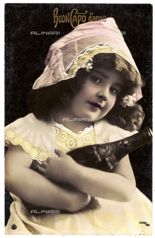 AVQ-A-003757-0025 - Portrait of a young little girl carrying a champagne bottle in her hands, new year greeting post-card with a 'Buon Capo d'anno' inscription on the front side and a personal dedication on the back side, Austria