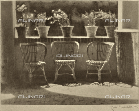"BCA-F-000197-0000 - ""Windowsill."" Three wicker armchairs lined up on a terrace, some flowering plants are on the sill"