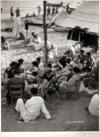 "BCA-F-000204-0000 - ""The evening respite on the beach of Varazze."" Scene of the life of people vacationing at the beach"