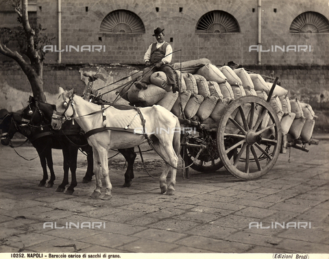BGA-F-010252-0000 - A carter on a cart loaded with sacks of wheat.