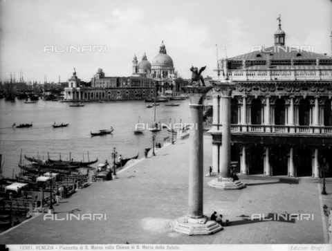 BGA-F-012391-0000 - View of the lagoon from Piazzetta, S. Marco, Venice. Two monolithic columns topped by a statue of the Lion of St. Mark and St. Theodor and the Church of S. Maria della Salute.