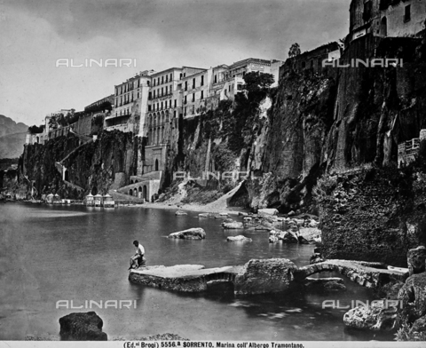 BGA-F-05556A-0000 - View of the coastline of Sorrento, with the Hotel Tramontano. A man sitting on a rock is looking out to sea