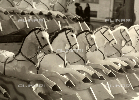 "BVA-F-002137-0000 - ""The Cavalcade"". Rocking horses displayed outdoors."