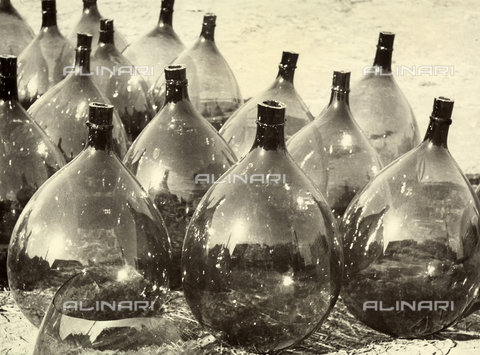 "BVA-F-002630-0000 - ""Demijohns'. Demijohns placed on the ground in a series of rows."