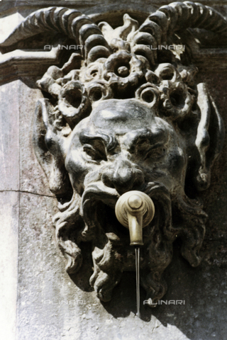 BVA-F-005425-0000 - Head of satyr, detail of the monumental cast iron fountain, in Piazza Santa Domitilla, Terracina - Date of photography: 1955-1965 - Fratelli Alinari Museum Collections-Balocchi Archive, Florence