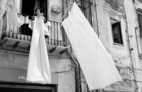 BVA-S-S10008-0030 - Woman applying cloths - Date of photography: 06/1961 - Fratelli Alinari Museum Collections-Balocchi Archive, Florence