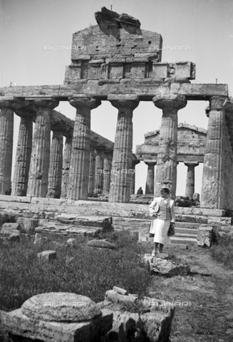 CAD-S-290047-0028 - Woman visiting the remains of the Temple of Ceres or Athena in Paestum - Date of photography: 1930 ca - Fratelli Alinari Museum Collections-Cammarata Donation, Florence