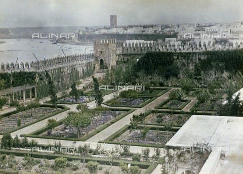 CHA-F-AU0616-0000 - A garden inside the walls of the Oudaia Kasbah and a view of Rabat, Morocco - Data dello scatto: 1907 - Archivi Alinari, Firenze